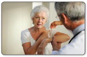 physician looking at shoulder